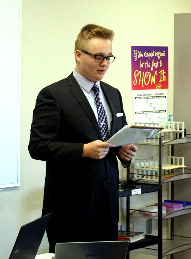 Giving his side of the debate,  junior Hunter Cowdrey talks with his notes in his hand while participating in a debate with Raeef Rahman against another pair. The debate team held their first meet against Shanley students on November 12th.